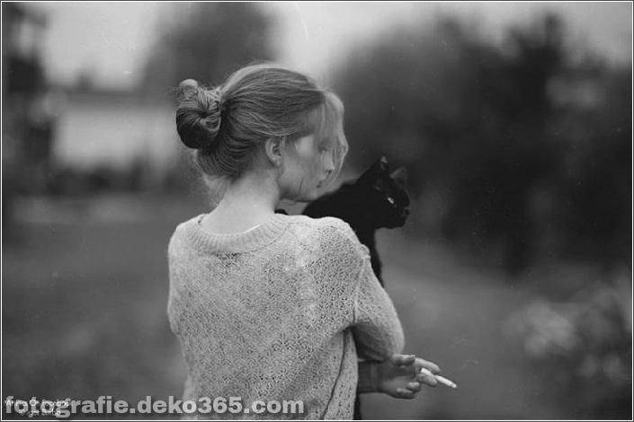 Katze mit Mädchen_5c906147923c5.jpg